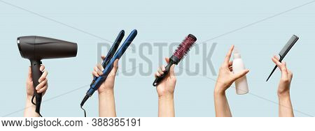 Woman Hands Holding Hairdryer, Straightener, Hairbrush, Tail Comb And Hair Care Essence In Bottle Is