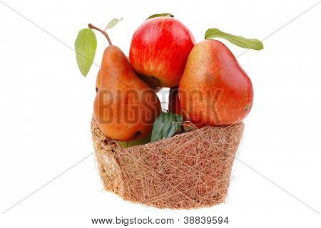 group of red and green fresh ripe apples and gold pear in basket isolated over white background