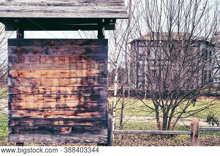 Old Wooden Noticeboard On The Background Of The Ancient City And Trees, Copy Space, Background