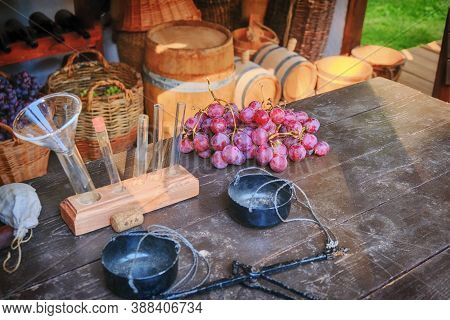 Creating Wine From Grapes. Professional Winemaking From Ripe Grapes - Barrels, Test Tubes And Scales