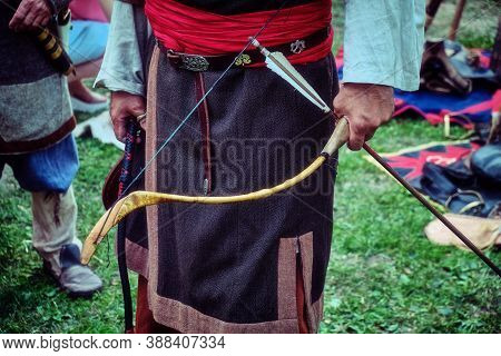 Archer Buryat Tribe Stands With A Bow In His Hand. Reconstruction Of The Life Of The Nomadic Peoples