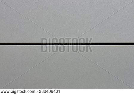 Background Metal Plate Of Two Halves, Copy Space. The Surface Texture Of The Steel Divided In Half.,