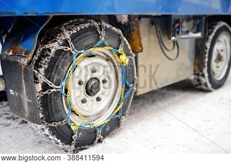 Saas-fee, Switzerland - February 4, 2020: Chains On The Wheels Of A Company Car In The Mountain Reso