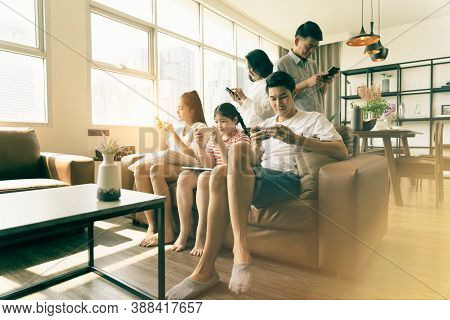 Social Media Addiction Concept, Everyone In Family Using Mobile Phone In The Living Room. Problem Of