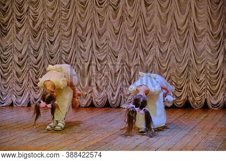 Girls Bow To The Audience After The Performance On Stage. The End Of The Song In The Vocal Competiti