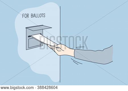 Politics, Election, America, Voting Concept. Man Voter Citizen Hand Putting Absentee Sheet Of Paper