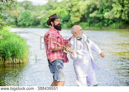 He Must Use It. Retired Businessman. Male Friendship. Family, Granddad And Drandson Fishing. Hobby A