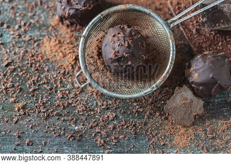 Delicious Chocolate Truffles With Cocoa Powder And Dark Chocolate On A Dark Wooden Background.
