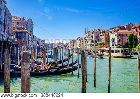 Venice, Italy, September 13, 2019: Gondolier On Moored Gondola Traditional Boat On Water Of Grand Ca