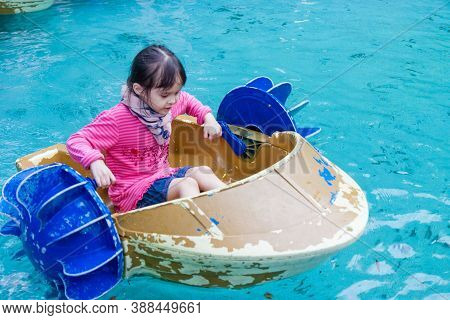 Young Girl In Paddle Boat