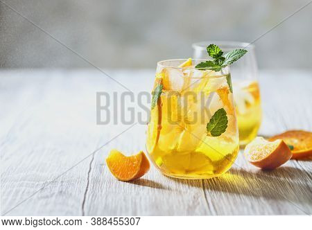 Homemade Refreshing Iced Tea With Orange And Lemon On A Wooden Rustic Table. Summer Refreshing Drink