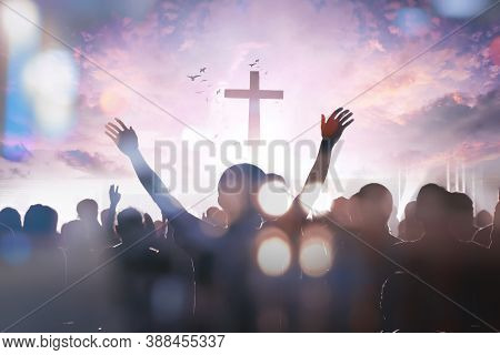 Christian People Group Raise Hands Up Worship God Jesus Christ Together On Cross Over Cloudy Sky Bac