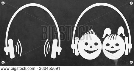 Headphones As A Sign For Audio Guide And Audio Guide For Children On Black Background
