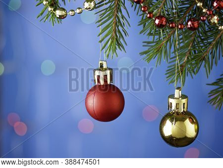Colorful Christmas Balls Hang On The Christmas Tree On A Beautiful Background
