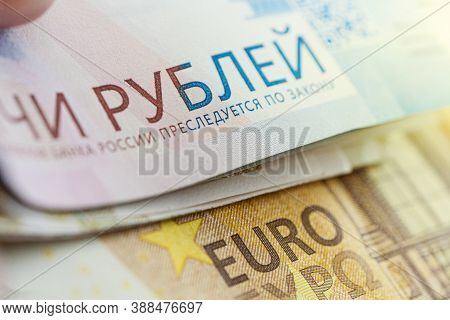 Exchange Of Euros For Rubles. Currency Devaluation. Banknotes Close -up. The Concept Of The Financia