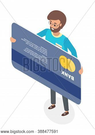 A Happy Man Standing Holding His Credit Card Isolated On White. Micro Male Character In Glasses And