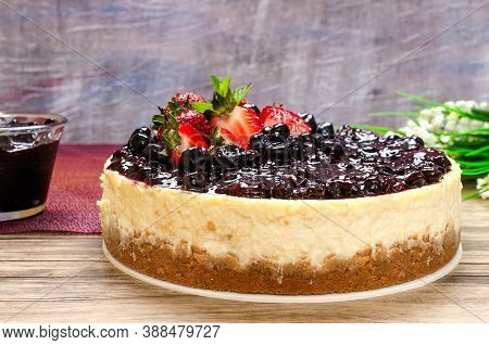 Beautiful And Delicious New York Cheescake, Decorated With Red Berries, Blackberry, Blueberries And