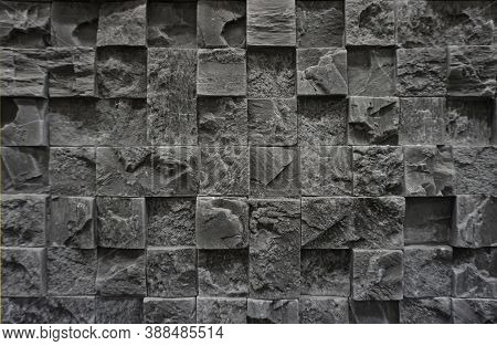 Grey Cladding Wall Made Of Stoneware With Interlocking Tiles. Background And Texture. Pattern