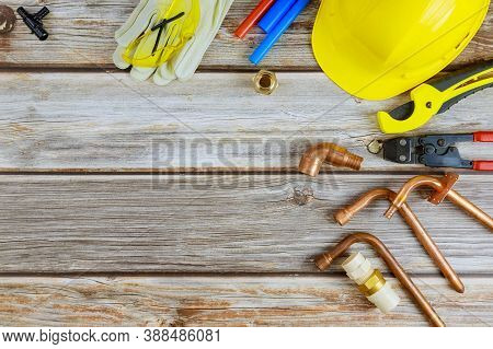 Top View Plumbing Tools On Hose Connectors Plumbers Tools Materials Including Copper Pipe, Elbow Joi