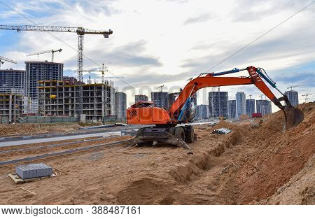 Excavator Dig Trench At A Construction Site. Trench For Laying Sewer Pipes. Sewage Drainage System F
