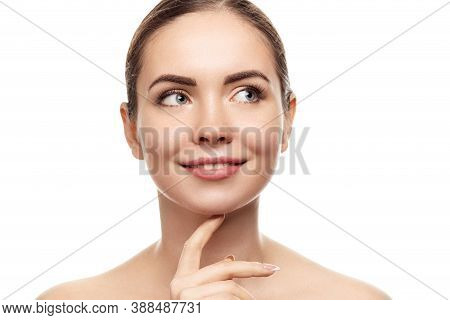 Beautiful Young Woman With Clean Fresh Skin Look Away. Girl Beauty Face Care. Facial Treatment. Skin