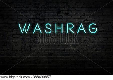 Neon Sign On Brick Wall At Night. Inscription Washrag