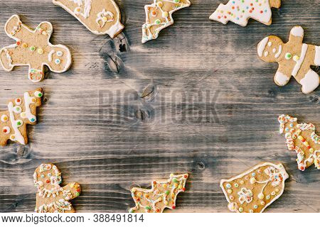 Christmas Homemade Gingerbread Cookies With Cinnamon And Anise On Old Wooden Background Frame With S