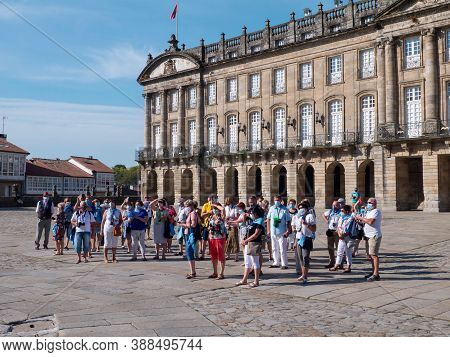 Santiago De Compostela, Spain - September 13, 2020:  Tourists Make Photo Of The Cathedral On The Obr