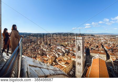 Florence, Italy - February 13, 2018: Two Oriental Women Looking From Above At The Full View Of Flore
