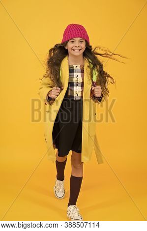 Happy Walk. Fashion Accessory. Fancy Schoolgirl. Girl Little Fashionable Pupil Wear Knitted Hat And
