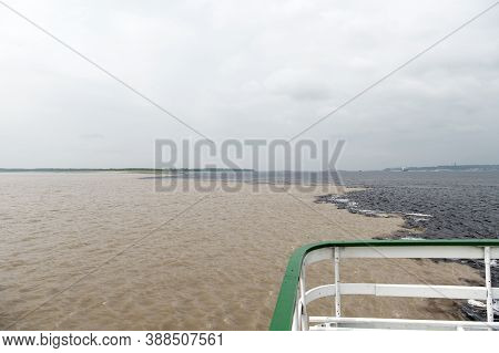 Water Meeting In Brazil -amazon River With Rio Del Negro Clean And Dirty River Water With Different