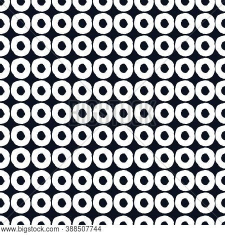 Seamless Geometric Pattern With Hand Drawn Uneven White Rings On Black Background For Surface Design