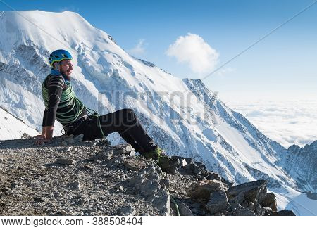 Smiling Bearded Climber With Huge Backpack With Climbing Rope Showing Thumb Sign Enjoying A French A