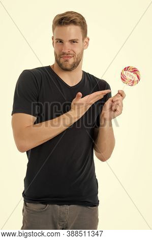 Candy Made For Love. Handsome Guy Show Candy With Love Word Lettering. Unshaven Bachelor Hold Candy