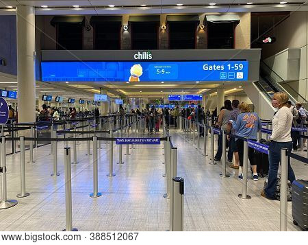 People Walking Through The Security Line At Orlando International Airport Mco.