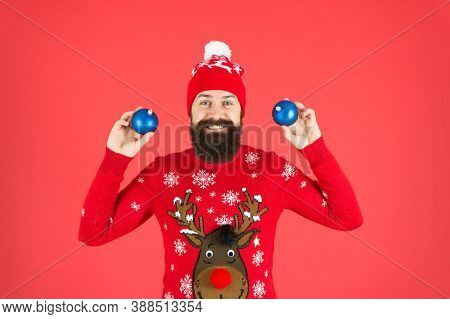 New Year Concept. Hipster Smiling Cheerful Bearded Man Wear Winter Sweater And Hat Hold Balls. Chris