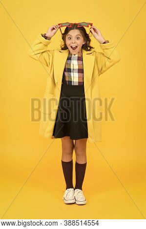 Perfect For School Party. Happy Party Girl Yellow Background. Little Kid Wear Party Glasses With Col
