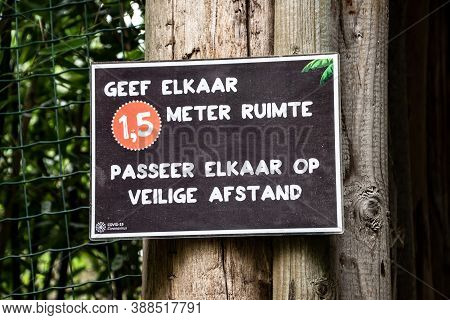 Overloon, Netherlands - October 4, 2020: Attention Board (written In Dutch) Before Store To Keep Soc