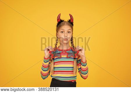Creating Spooky Holiday Look. Small Girl Wear Halloween Holiday Costume Accessories. Little Child Dr