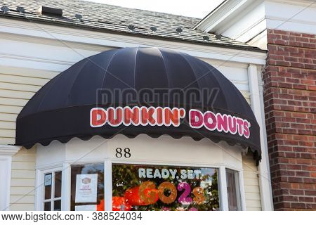 NEW CANAAN, CT, USA - OCTOBER 4, 2020: Dunkin` Donuts` store sign in New Canaan downtown  on Elm Street