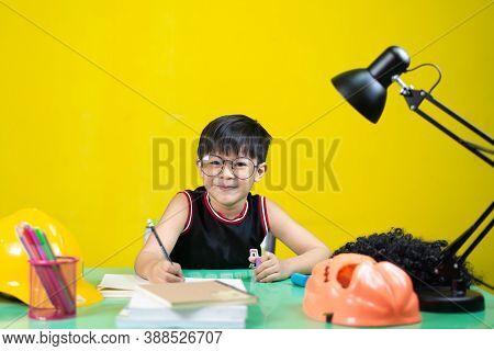 Happy Children Wearing Glasses Doing Homework, Learning Equipment On The Table.