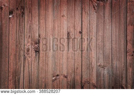 Fencing From Gray Old Wooden Boards Background