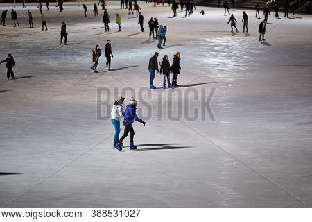 BUDAPEST, HUNGARY - CIRCA 2020: People ice skating on the City Park Ice Rink, the largest and one of the oldest ice rinks in Europe. Enjoying winter outdoor activities