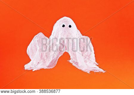 Diy Halloween Ghost Of Starch And Gauze On Orange Background. Gift Idea, Decor Halloween. Kid Childr