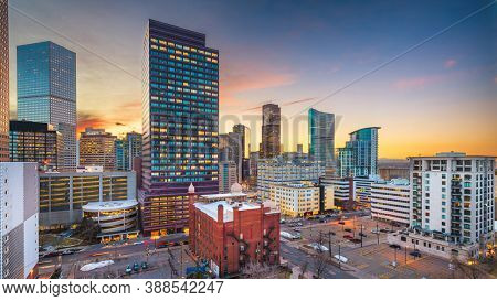 Denver, Colorado, USA downtown cityscape rooftop view at dusk.