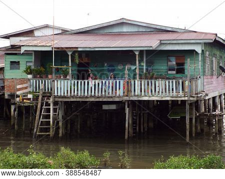 Bandar Seri Begawan, Brunei, January 25, 2017: A Family On The Porch Of A House In Kampong Ayer Floa