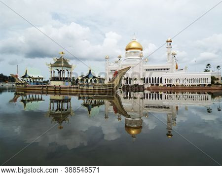Bandar Seri Begawan, Brunei, January 29, 2017: Reflections In The Water Of The Boat And The Mosque O