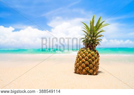 Pineapple On Tropical Beach Background. Summer Vacation And Healthy Food Concept.