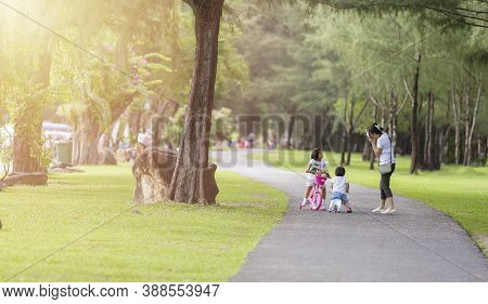 Family In Park Concept. Mother And Her Daughter Play At Park Together. Mother Shot Her Daugther With