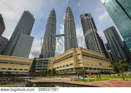 Kuala Lumpur, Malaysia - December 2, 2019: Cityscape Of The Petrona Twin Towers And Buildings In Kua